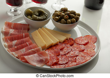 Antipasto with cured meat, sausage, cheese, green olives,...
