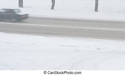 Cars passing by in winter on snow covered road - Various...