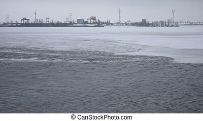 Ice melting on water storage reservoir near Kiev, Ukraine -...