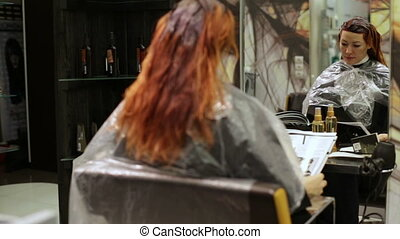 Woman with fashion-paper during visit in salon - Woman with...