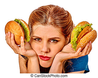 Girl eating big sandwich. - Upset girl holding two big...