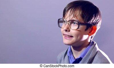 boy nerd teenager portrait schoolboy glasses on purple...