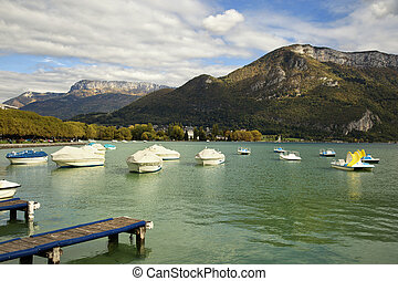 rowing boats on Annecy canal - Boats at the riverside in...