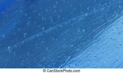 rain splashes water flows blue background - rain splashes...