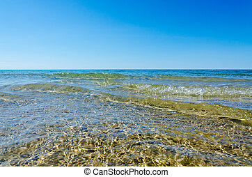 clear water - Light, shadow and clear water at shore of...