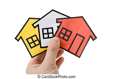 Real Estate Concept - Hand holding a home sign, Real Estate...