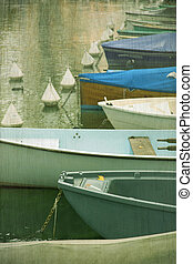 rowing boats on Annecy canal - Detail of colourful profil...