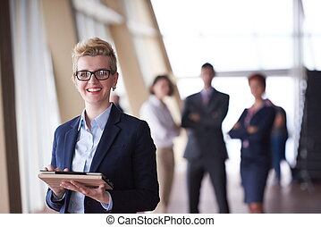 business woman at office with tablet in front as team leader...
