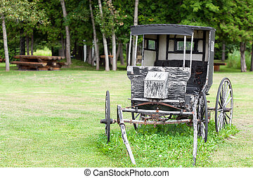 Old style stage coach on field