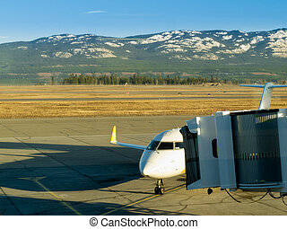 Aircraft docked at Whitehorse airport Yukon Canada -...