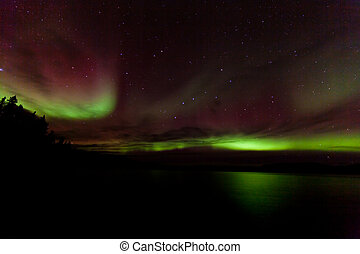 Colorful Aurora borealis over Lake Laberge Yukon Canada -...