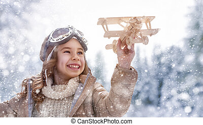 playing with toy plane - happy child playing with toy plane...