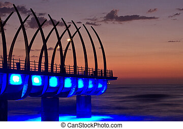 Umhlanga Pier sunrise - Sunrise over Umlanga Pier with blue...
