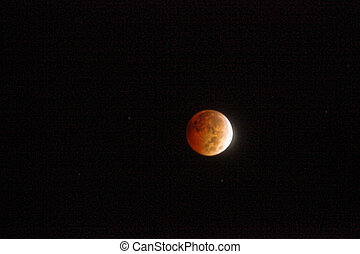 Lunar Eclipse - The moon entering the blood red glow during...