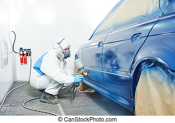worker painting auto car body - automobile repairman painter...