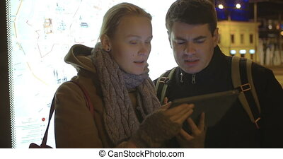 Tourists Walking in Tallinn with Tablet - Two tourists are...