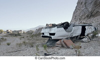Abandoned car in a marble quarry