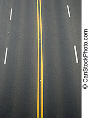 double yellow lines and white lines divider on blacktop