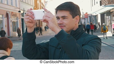 Male Tourist Taking Photos of Tallinn Streets - Male tourist...