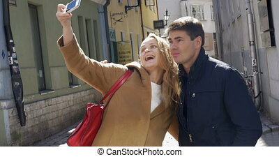 Couple Taking Selfie with Smartphone in Tallinn - Young...