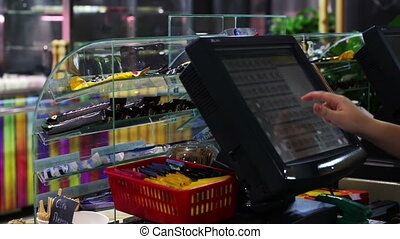 The cashier working the store - Woman cashier working behind...