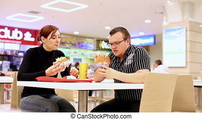 Man and woman in fast food - Man and woman in fastfood eat...
