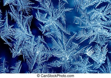 Frosty - Frost formations on a window with dark background
