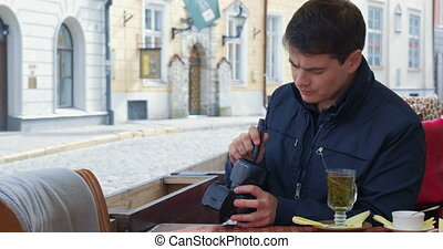 Man Cleaning Camera Lens And Taking Pictures - Tourist...