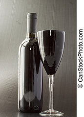 Black glass and wine bottle - A black glass for wine over...