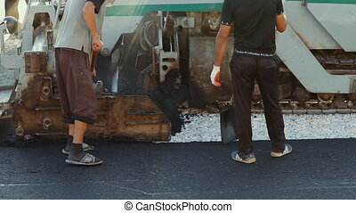 Laying asphalt pavement using special equipment - Volgograd,...