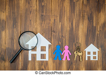 couple searching a new big house, paper house with key on...