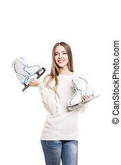 young woman with pair of ice skates isolated - Smiling young...