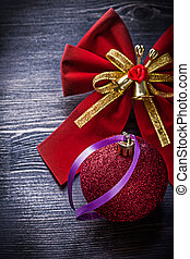 Christmas bow toy on wooden board holidays concept