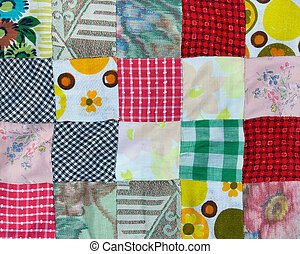 Patchwork background - Section of a hand-stitched patchwork...