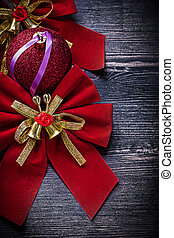 Christmas red knots ball on wooden board holidays concept