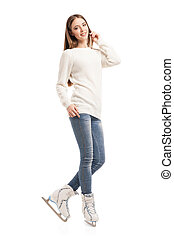 young woman in pair of ice skates isolated - Smiling young...