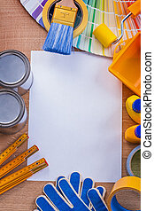 Composition of painting tools on wood board construction concept