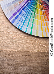 Multicolored pantone fan on wooden board construction...