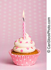 Spots and stripes - Spotty pink cupcake with a stripey...