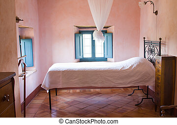 Rustic bedroom of a Tuscan farm house