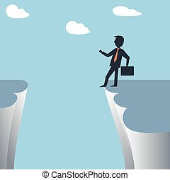 Businessman at the edge of cliff