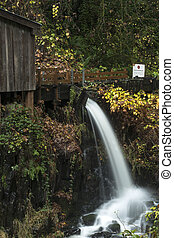 Cedar Creek Grist Mill Water Spout - An autumn view of the...