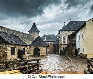 inside yard of Khotyn Fortress under rain