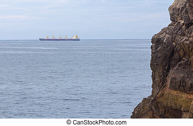 Merchant ship sailing by sea