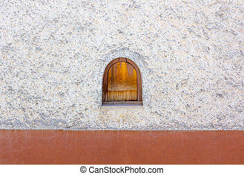 Small window in white facade