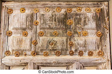 Background detail of old wooden door and rivets