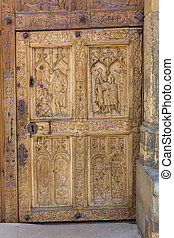 Detail of old wooden door carved