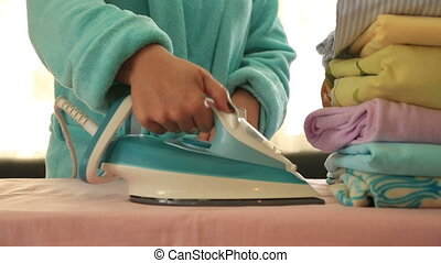 Woman ironing clothes - Portrait of a happy woman ironing...