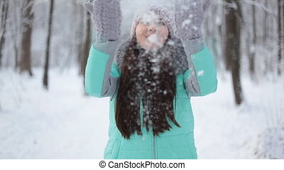 Girl throws snow - Female woman throws her arms up into the...