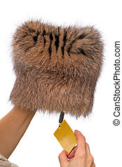 Hands with a new fur cap Isolated on a white background